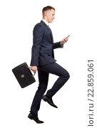 Купить «Running businessman with his briefcase and mobile phone on white», фото № 22859061, снято 11 мая 2016 г. (c) Владимир Мельников / Фотобанк Лори