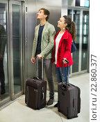 Купить «Positive young people with luggage standing», фото № 22860377, снято 15 июля 2020 г. (c) Яков Филимонов / Фотобанк Лори