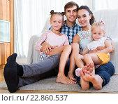 Купить «Relaxed family in domestic interior», фото № 22860537, снято 22 ноября 2018 г. (c) Яков Филимонов / Фотобанк Лори