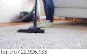Купить «woman with vacuum cleaner cleaning carpet at home», видеоролик № 22926133, снято 17 апреля 2016 г. (c) Syda Productions / Фотобанк Лори