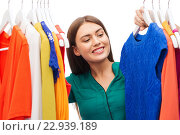 Купить «happy woman choosing clothes at home wardrobe», фото № 22939189, снято 19 февраля 2016 г. (c) Syda Productions / Фотобанк Лори