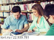 Купить «students with books preparing to exam in library», фото № 22939781, снято 6 марта 2015 г. (c) Syda Productions / Фотобанк Лори