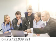 Купить «business team with laptop having discussion», фото № 22939921, снято 9 ноября 2013 г. (c) Syda Productions / Фотобанк Лори