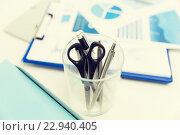 Купить «close up of cup with scissors and pens at office», фото № 22940405, снято 18 июня 2015 г. (c) Syda Productions / Фотобанк Лори
