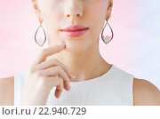 Купить «close up of beautiful woman face with earrings», фото № 22940729, снято 14 апреля 2016 г. (c) Syda Productions / Фотобанк Лори