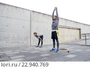 Купить «tired couple stretching after exercise», фото № 22940769, снято 17 октября 2015 г. (c) Syda Productions / Фотобанк Лори