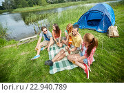 Купить «happy friends with drinks and guitar at camping», фото № 22940789, снято 25 июля 2015 г. (c) Syda Productions / Фотобанк Лори