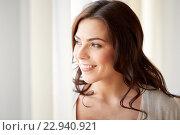 Купить «happy young woman looking through window at home», фото № 22940921, снято 23 марта 2016 г. (c) Syda Productions / Фотобанк Лори