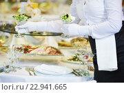 Купить «Restaurant services. Female waitress serving table», фото № 22941665, снято 30 марта 2016 г. (c) Дмитрий Калиновский / Фотобанк Лори