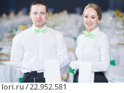 Купить «Catering service. waitress and waiter on duty», фото № 22952581, снято 30 марта 2016 г. (c) Дмитрий Калиновский / Фотобанк Лори