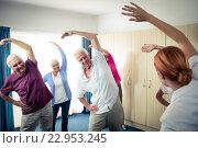 Купить «Group of seniors doing exercises with nurse», фото № 22953245, снято 22 марта 2016 г. (c) Wavebreak Media / Фотобанк Лори
