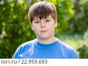 Купить «boy of about 12 years in Park», фото № 22959693, снято 15 мая 2016 г. (c) Володина Ольга / Фотобанк Лори
