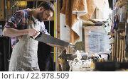 Купить «carpenter working with saw and wood at workshop», видеоролик № 22978509, снято 21 мая 2016 г. (c) Syda Productions / Фотобанк Лори