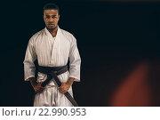 Купить «Composite image of fighter tightening karate belt», фото № 22990953, снято 18 августа 2019 г. (c) Wavebreak Media / Фотобанк Лори