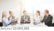 Купить «business team with laptop clapping hands», фото № 23003365, снято 9 ноября 2013 г. (c) Syda Productions / Фотобанк Лори