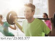 Купить «group of people exercising with barbell in gym», фото № 23003377, снято 5 апреля 2015 г. (c) Syda Productions / Фотобанк Лори