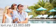 Купить «happy family over hotel resort swimming pool», фото № 23003689, снято 4 августа 2013 г. (c) Syda Productions / Фотобанк Лори