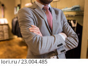Купить «close up of man in suit and tie at clothing store», фото № 23004485, снято 1 апреля 2016 г. (c) Syda Productions / Фотобанк Лори