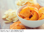 Купить «close up of corn crisps or nachos in bowl», фото № 23004521, снято 22 мая 2015 г. (c) Syda Productions / Фотобанк Лори