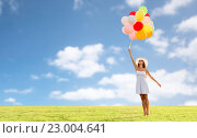 smiling young woman in sunglasses with balloons. Стоковое фото, фотограф Syda Productions / Фотобанк Лори