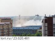 Купить «Zelenograd, Russia - May 31.2016. Extinguishing the fire by helicopter», фото № 23020481, снято 31 мая 2016 г. (c) Володина Ольга / Фотобанк Лори