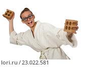 Купить «Funny woman in kimono with brick on white», фото № 23022581, снято 18 июля 2015 г. (c) Elnur / Фотобанк Лори