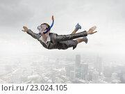 Купить «Businesswoman diver in free fall», фото № 23024105, снято 24 февраля 2011 г. (c) Sergey Nivens / Фотобанк Лори