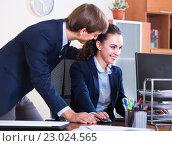 Купить «Boss touching subordinate employee», фото № 23024565, снято 27 февраля 2020 г. (c) Яков Филимонов / Фотобанк Лори
