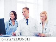Купить «doctors looking at computer on meeting», фото № 23036013, снято 6 июля 2013 г. (c) Syda Productions / Фотобанк Лори
