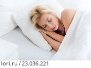 Купить «young woman sleeping in bed at home bedroom», фото № 23036221, снято 25 февраля 2016 г. (c) Syda Productions / Фотобанк Лори