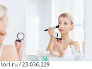 Купить «woman with makeup brush and blush at bathroom», фото № 23036229, снято 13 февраля 2016 г. (c) Syda Productions / Фотобанк Лори