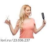 Купить «young woman with scissors and hairbrush», фото № 23036237, снято 30 апреля 2016 г. (c) Syda Productions / Фотобанк Лори
