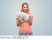 Купить «happy young woman with euro cash money», фото № 23036673, снято 30 апреля 2016 г. (c) Syda Productions / Фотобанк Лори