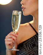 Купить «close up of woman drinking champagne at party», фото № 23036729, снято 9 апреля 2016 г. (c) Syda Productions / Фотобанк Лори