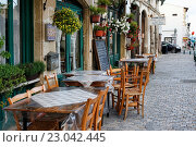 Купить «Маленькое кафе на улице Ларнаки, Кипр», фото № 23042445, снято 23 мая 2016 г. (c) Морозова Татьяна / Фотобанк Лори