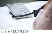 Купить «woman hand dialing number on telephone at office», видеоролик № 23048869, снято 18 марта 2016 г. (c) Syda Productions / Фотобанк Лори