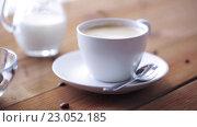 Купить «coffee cup and beans pouring to wooden table», видеоролик № 23052185, снято 15 апреля 2016 г. (c) Syda Productions / Фотобанк Лори