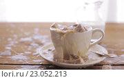 Купить «coffee and sugar falling to cup on table», видеоролик № 23052213, снято 15 апреля 2016 г. (c) Syda Productions / Фотобанк Лори