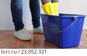 Купить «woman washing and squeezing rag in bucket at home», видеоролик № 23052321, снято 17 апреля 2016 г. (c) Syda Productions / Фотобанк Лори