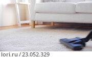 Купить «woman with vacuum cleaner cleaning carpet at home», видеоролик № 23052329, снято 17 апреля 2016 г. (c) Syda Productions / Фотобанк Лори