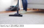 Купить «woman with vacuum cleaner cleaning carpet at home», видеоролик № 23052333, снято 17 апреля 2016 г. (c) Syda Productions / Фотобанк Лори