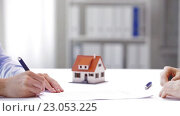 Купить «business partners with house keys and contract», видеоролик № 23053225, снято 15 мая 2016 г. (c) Syda Productions / Фотобанк Лори