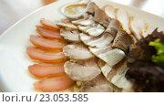 Купить «Мясные деликатесы», видеоролик № 23053585, снято 26 апреля 2016 г. (c) Илья Шаматура / Фотобанк Лори