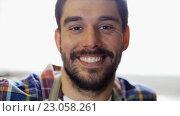 Купить «workman in checkered shirt and apron at workshop», видеоролик № 23058261, снято 21 мая 2016 г. (c) Syda Productions / Фотобанк Лори