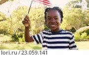 Купить «Happy boy waving American Flag at park», видеоролик № 23059141, снято 26 мая 2020 г. (c) Wavebreak Media / Фотобанк Лори