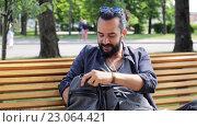 Купить «Man with backpack and earphones in city», видеоролик № 23064421, снято 3 июня 2016 г. (c) Syda Productions / Фотобанк Лори