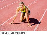 Купить «Female athlete ready to run on running track», фото № 23065893, снято 13 января 2016 г. (c) Wavebreak Media / Фотобанк Лори