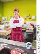 Купить «Portrait of butcher man smiling and posing», фото № 23070929, снято 16 октября 2015 г. (c) Wavebreak Media / Фотобанк Лори