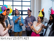 Купить «Happy coworker opening a bottle of champagne for birthday», фото № 23071421, снято 19 марта 2016 г. (c) Wavebreak Media / Фотобанк Лори