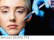 Купить «Woman receiving botox injection on her lips», фото № 23072713, снято 3 февраля 2016 г. (c) Wavebreak Media / Фотобанк Лори